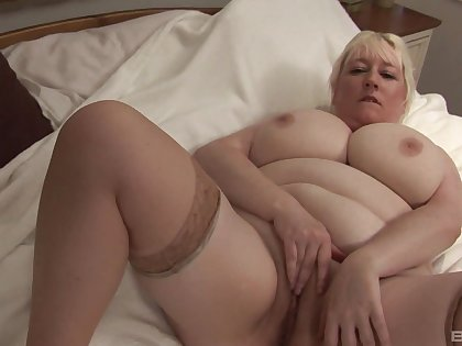 Big-busted mature blonde amateur gets naked coupled with plays with her cunt