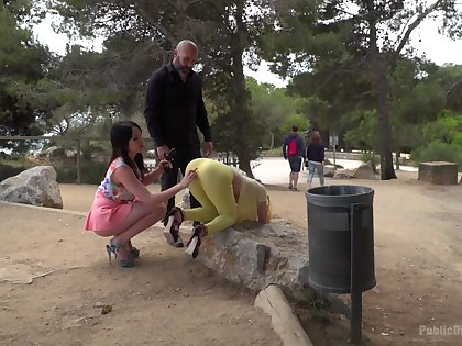 Outdoor fun in the park for two sluts together with their versed dick