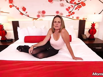 Skinny brunette milf here saggy tits, Judith, is riding a hard sickly cock for a camera