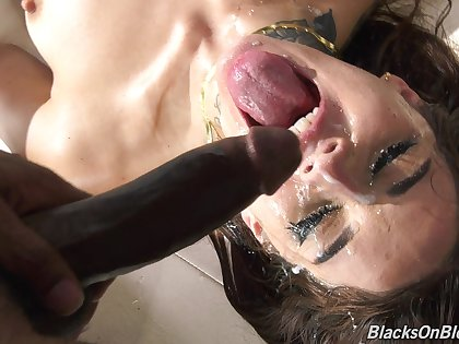 Tattooed slut Vanessa Vega gets all of her holes fucked at the end of one's tether black dudes